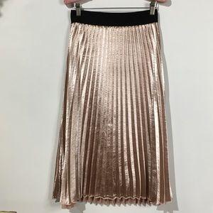 Ultra shiny rose gold pleated skirt